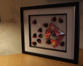 Dozen Hearts & Choc with a hand made  packet a wood and glass frame.