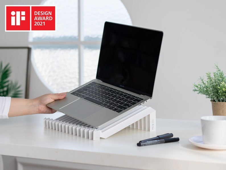 g.flow stone: Foldable & Portable Laptop Stand image 0