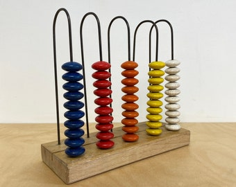 Old abacus from 'Jegro bv - Bolsward'    vintage   woodplay   decoration   children   Dutch toy