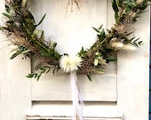 Spring wreath in heart shape Eucalyptus Euphorbia spinosa olive branches feathers dried flowers