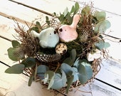Floral Easter nest with birds of rice, moss, eucalyptus