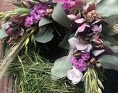 Flower wreath of hay, lilac, eucalyptus, hydrangeas, nigella, oats, barley