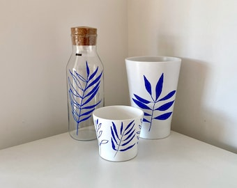 White Plant Pot with minimalist leaf design in blue