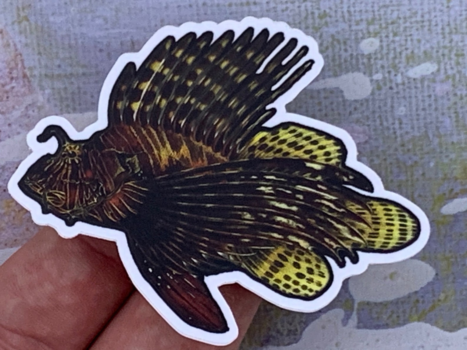 Photo of a red lionfish magnet in someone's hand