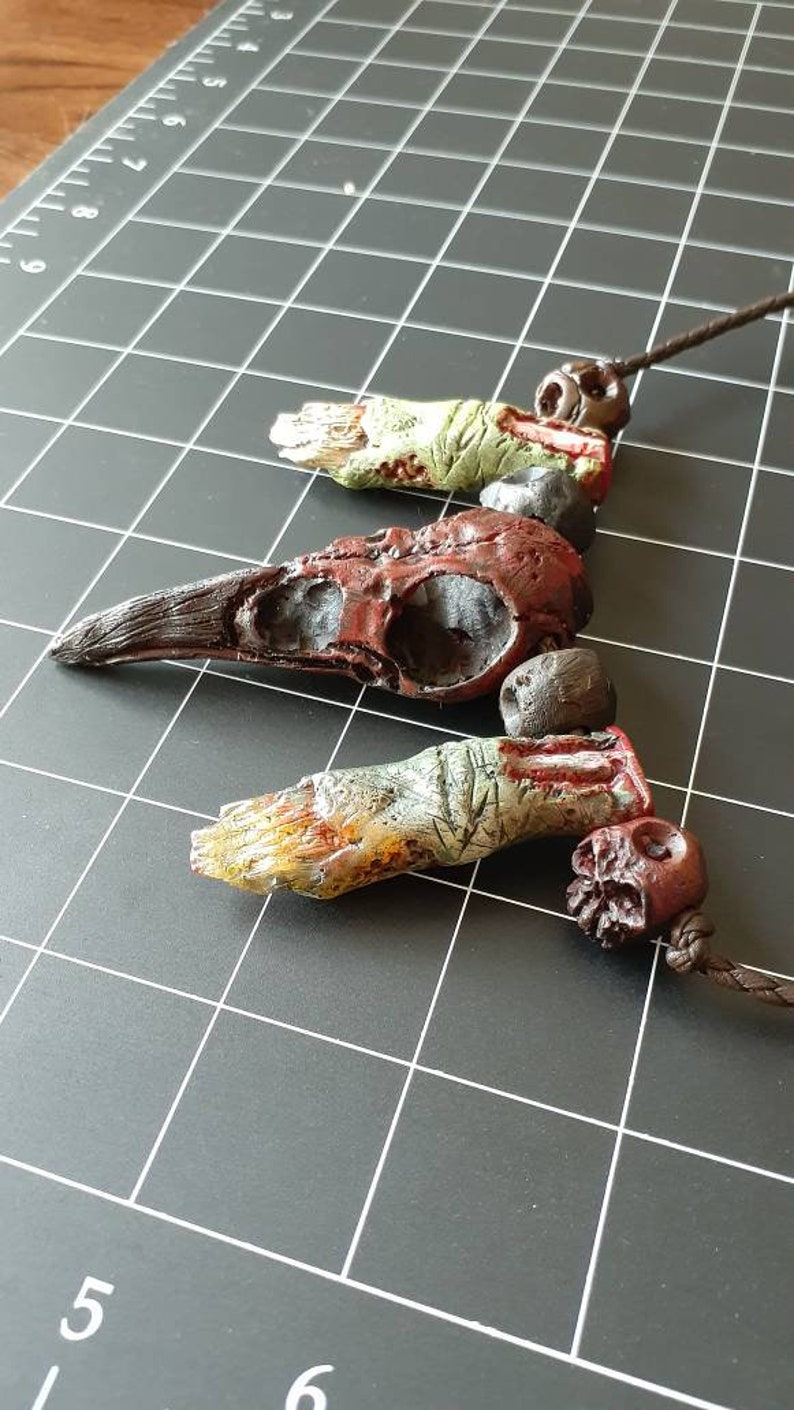 Raven crow skull and zombie finger necklace