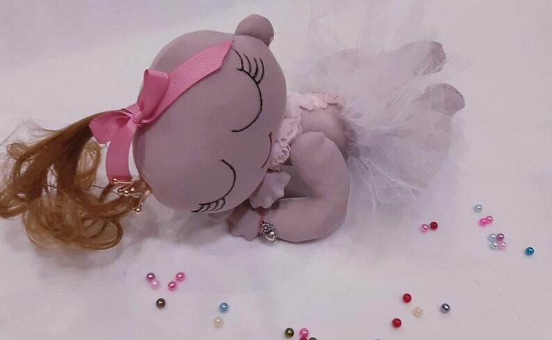 Decorative textile doll