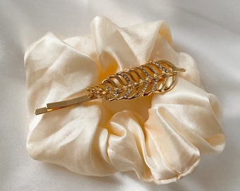 Hair clip with feather brooch and rhinestones, filigree, hair accessories in gold