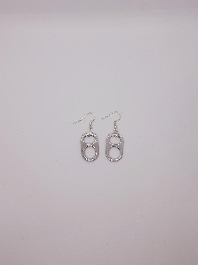 Can cap earrings