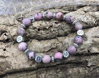 Personalized frozen rhodonite gem bracelet with silver intermediate elements