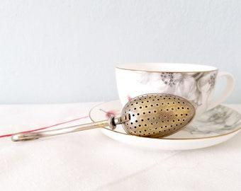 vintage tea infuser, retro tea strainer, stainless steel herbal infuser, antique tea gadget, vintage tea kitchenware, vintage tea set