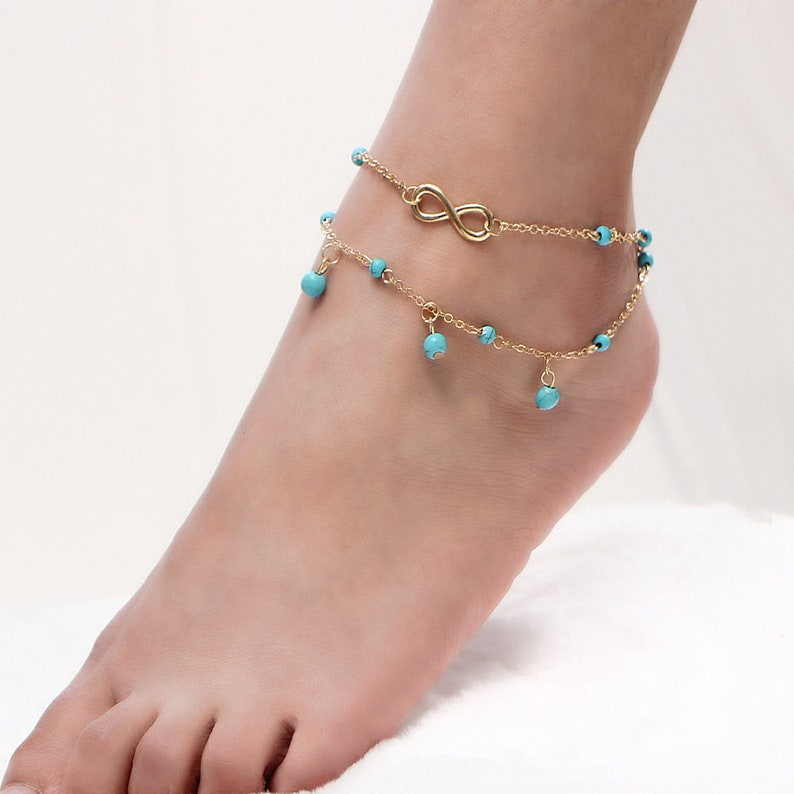 Both Made with Alloy Available in Silver Colour or Gold Colour Infinity and Turquoise Bead Multi Chain Anklet Perfect for Summer!