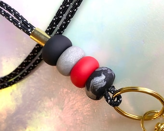 Silver, Red, and Black Lanyard