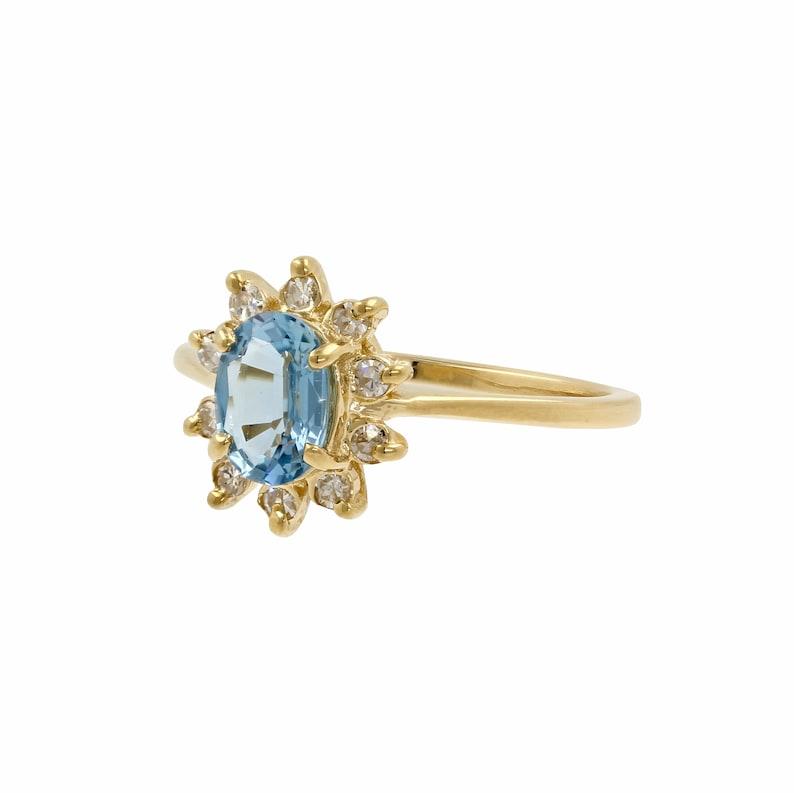 1.35ctw 14k Yellow Gold Oval Blue Topaz Round Diamond Halo Cocktail Ring
