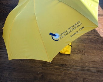 Bright Yellow Umbrella Supporting Cancer Research