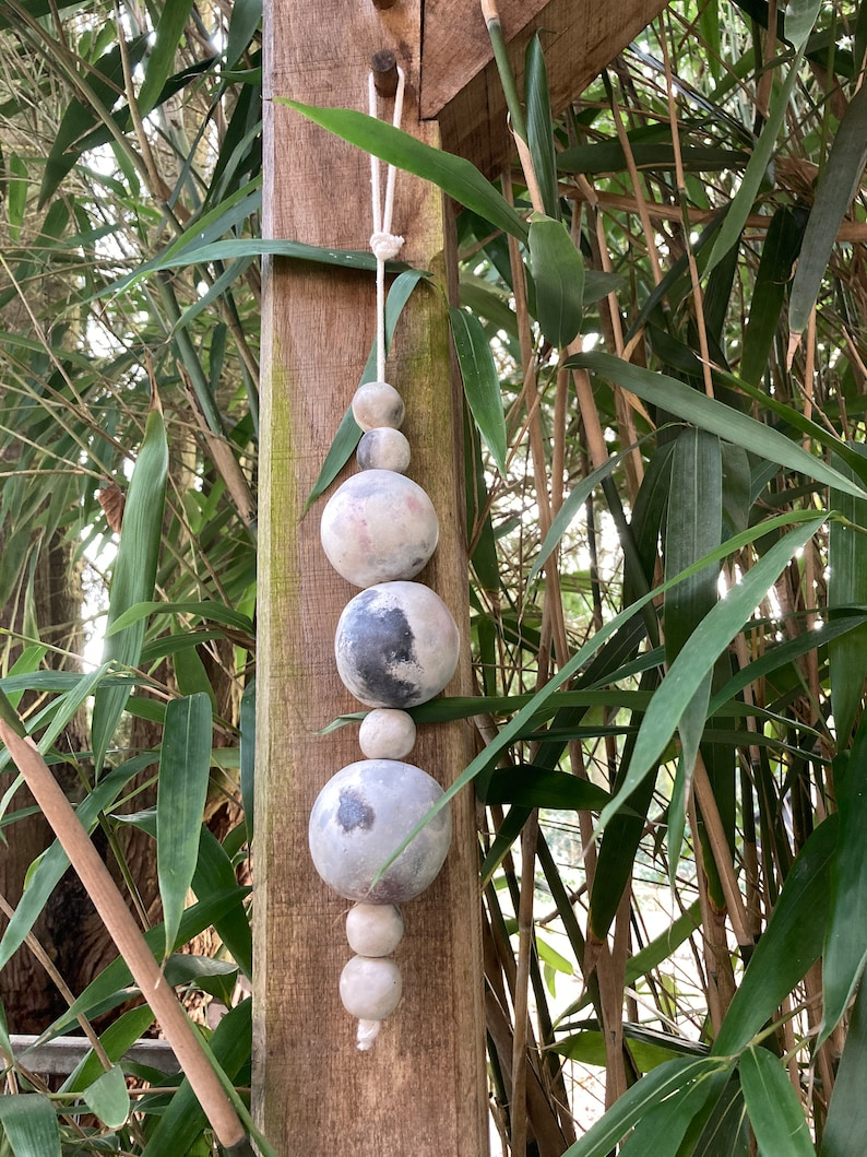 Ceramic beads on cord. image 0
