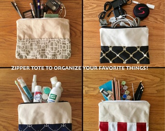 Large canvas zippered pouch, with accent fabric, lined, interior pocket.  Great for cosmetics, toiletries, electronics, pencils, and more!