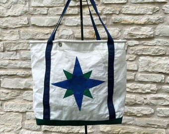Recycled sailcloth bag with blue/green compass rose, navy blue handles, forest green sunbrella bottom - bolt rope accent - recycled sail