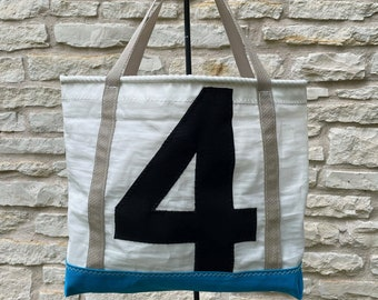 Recycled sailcloth bag with black number 4, tan handles, reinforced turquoise canvas bottom - bolt rope accent - recycled dacron sail