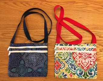 Cross-body 2 zipper purse, large interior compartment plus external pocket.  Colorful, durable, go anywhere bag.
