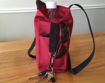 Water bottle tote with 2 external pockets,  crossbody strap, built in keyring holder, carabiner.  Hikes/Dog walks/Fitness/Birding/Travel