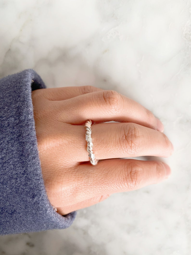 adjustable size Ring turned in silver color in irregular shape