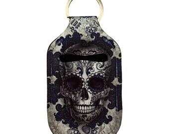 Turquoise and black sugar skull hand sanitizer holder