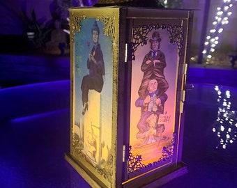 Haunted Mansion Stretching Room Portraits Lantern (Gold)