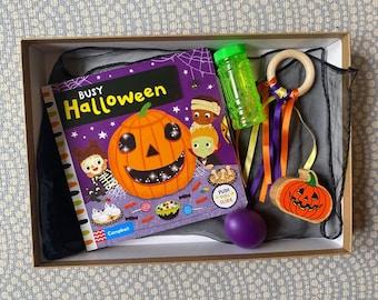 Halloween baby sensory box with wooden pumpkin