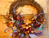 Gorgeous fall wreath with Vibrant fall leaves, persimmons, autumn grass, vine balls, and a grateful sign if you choose, autumn front door
