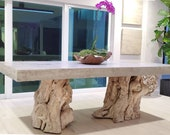 Concrete dining table with driftwood stump base