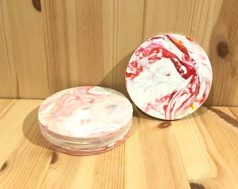 Set of four (4) red and white coasters made from recycled plastic