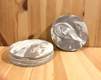 Set of four (4) grey and white coasters made from recycled plastic