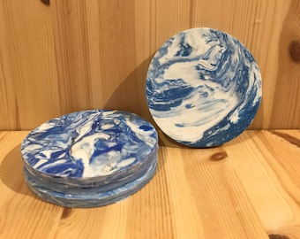 Set of four (4) blue and white coasters made from recycled plastic