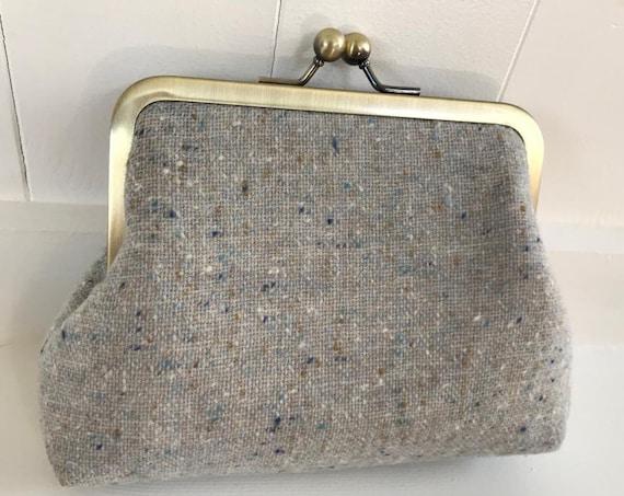 Tweed fabric clasp purse.