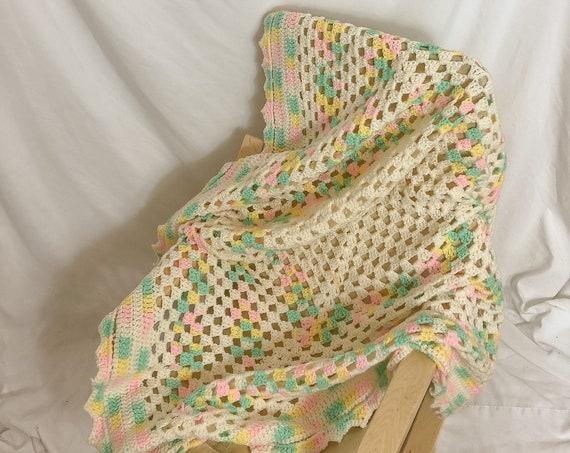 Pastel knit lap blanket