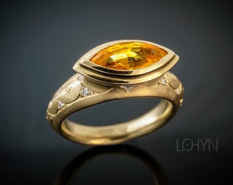 Yellow sapphire navette in 750/- gold with 14 lupen-pure diamonds
