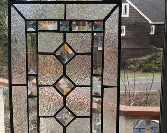 Beautiful  Leaded Glass WindowWall Hanging Featuring the Native American Avanyu symbol.
