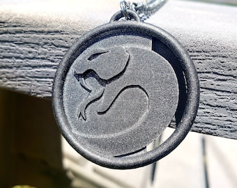 Tourmaline and viper crystal pendant