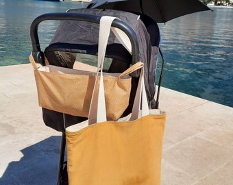 Small stroller bag as buggy organizer in mustard yellow