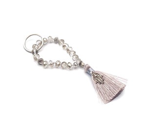 """Keychain """"Mini-Mala"""" made of faceted crystal beads, hand-knotted, with silver elements and hamsa hand and silk tassel"""