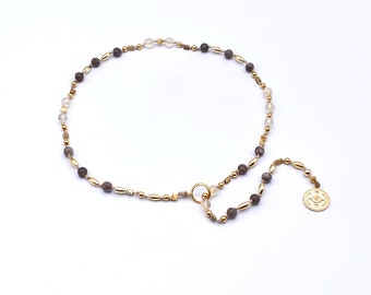 hand-knotted Y - necklace made of citrine and jasper, sent with golden pearls and coin pendants