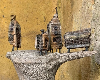 Contemporary rustic metal art decor with stoneware clay and driftwood piece
