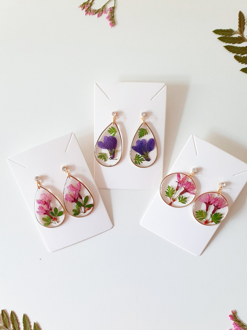 Pink resin earrings with real flowers cherry