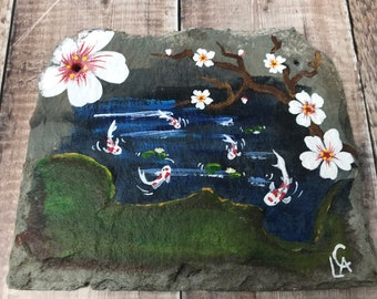 Hand painted on slate,Koi pond. Sealed for inside or garden
