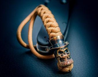 Paracord lanyard Dead Gentleman knife lanyard keychain 550 paracord beads custom Bronze biker edc key fob skull in hat cigar