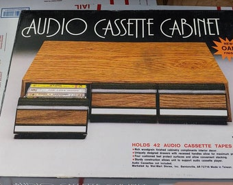 Audio Cassette Cabinet Brand New Inside The Original Box Packaging Collectors Item Very Rare!  Holds 42 audio cassette tapes!
