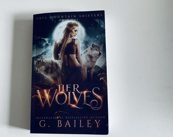 Signed copy of Her Wolves by G. Bailey + Free swag.