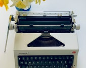 Like New, Olympia SM9 typewriter, De Luxe QWERTY, 1973, Superb Working Condition, Very Clean, with Case and Manual, Made Germany
