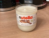 200g hand-cut and sanded nutella bottle soy wax candle. Each bottle made and poured by hand. A unique gift Chocolate Cookie scent.