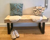 Rustic wooden bench made of old wood spruce beams